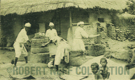 157b Cleaning rice circa 1900-1910