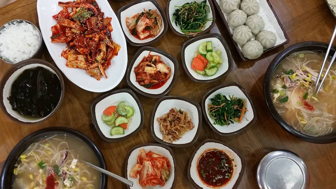 Jjimjilbagn During Winter: Hangover soup and spicy squid dish with mandu (dumplings) and lots of banchan (side dishes) at Siloam Spa Korean Restaurant