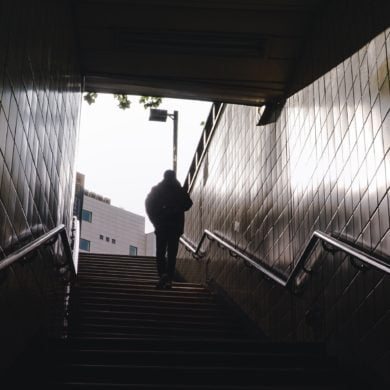 Person exiting a subway station in Seoul, South Korea