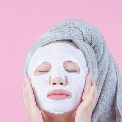 Woman wearing a sheet mask