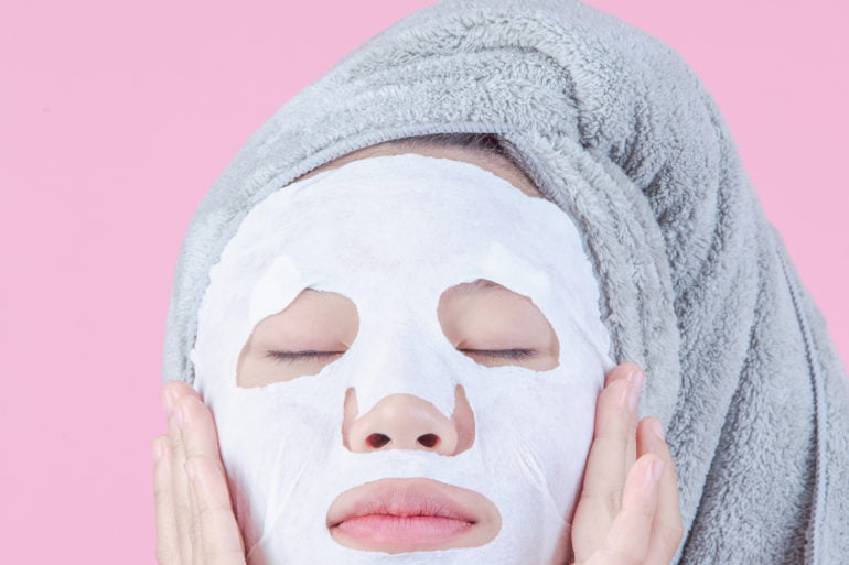 Woman wearing a sheet mask